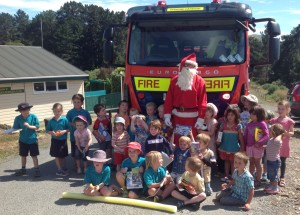 Santa bringing joy to the tamariki of Diamond Harbour Playcentre and Diamond Harbour School